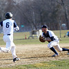 HADLEY GREEN/Staff photo<br /> Danvers' Trevor Lodi (10) tags Peabody's Teddy Vaillancourt (6) out at first base. <br /> <br /> 04/11/18