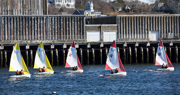 HADLEY GREEN/Staff photo<br /> Gloucester and Beverly boats sail off from the starting line during a race in the Gloucester Inner Harbor. <br /> <br /> 04/26/18