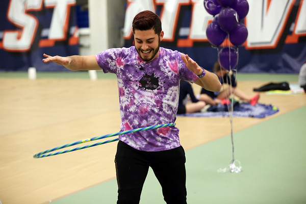 HADLEY GREEN/Staff photo<br /> Senior Dan Wilson competes in a hula hoop contest at Salem State University's Relay For Life event at the O'Keefe Center. <br /> <br /> 04/20/18