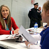 HADLEY GREEN/Staff photo<br /> Meghan Duggan signs an autograph for Emerson Hinchion, 6, of Peabody, at the Meghan Duggan Day rally.<br /> <br /> 04/07/18
