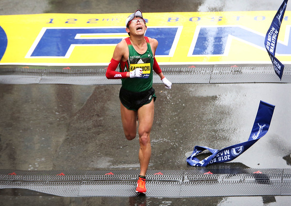 HADLEY GREEN/Staff photo<br /> Yuki Kawauchi of Japan crosses the finish line in the men's elite division at the 122nd Boston Marathon. <br /> <br /> 04/16/18