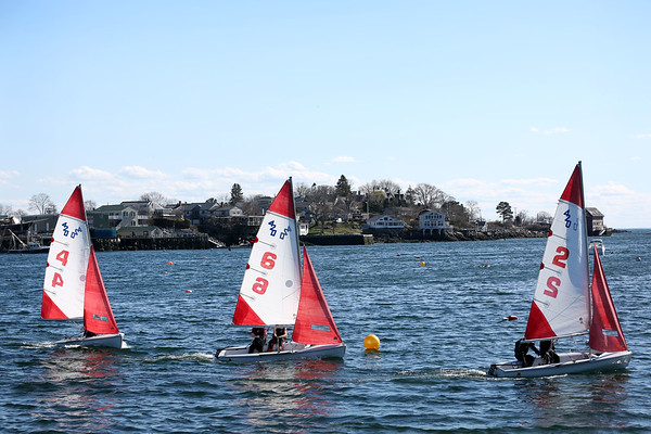 HADLEY GREEN/Staff photo<br /> Gloucester boats sail through the course at the Gloucester High School race against Beverly in the Gloucester Inner Harbor. <br /> <br /> 04/26/18