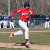 HADLEY GREEN/Staff photo<br /> Salem's Joey Baez (15) sprints towards first at the Danvers v. Salem boys baseball game at Twi Field in Danvers.<br /> <br /> 04/09/18