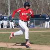 HADLEY GREEN/Staff photo<br /> Salem's Joey Baez (15) sprints towards first at the Danvers v. Salem boys baseball game at Twi Field in Danvers.<br /> <br /> 04/09/18