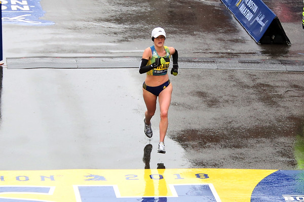 HADLEY GREEN/Staff photo<br /> Andover native Rachel Hyland crosses the finish line to come in fourth in the women's division at the 122nd Boston Marathon. <br /> <br /> 04/16/18