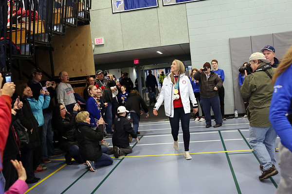 HADLEY GREEN/Staff photo<br /> Meghan Duggan walks into the Danvers High School field house for the Meghan Duggan Day Rally.<br /> <br /> 04/07/18
