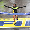 HADLEY GREEN/Staff photo<br /> Women's winner Desiree Linden of Michigan crosses the finish line at the 122nd Boston Marathon.<br /> <br /> 04/16/18