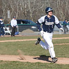 HADLEY GREEN/Staff photo<br /> Danvers' Tommy Mento (2) runs to first base at the Danvers v. Salem boys baseball game at Twi Field in Danvers.<br /> <br /> 04/09/18