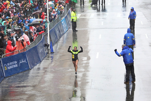 HADLEY GREEN/Staff photo<br /> Women's winner Desiree Linden of Michigan cheers as she runs down Boylston Street to come in first in the elite women's division at the 122nd Boston Marathon.<br /> <br /> 04/16/18