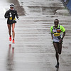 HADLEY GREEN/Staff photo<br /> Marblehead's Shalane Flanagan comes in seventh in the elite women's division at the 122nd Boston Marathon, trailing Shadrack Biwott, who came in third in the elite men's division. <br /> <br /> 04/16/18