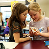 """HADLEY GREEN/Staff photo<br /> From left, Ellie Wright of Wenham and Margaret Madden of Hamilton play with their """"divination craft""""  at the Harry Potter event at the Hamilton-Wenham Public Library.<br /> <br /> 04/17/18"""
