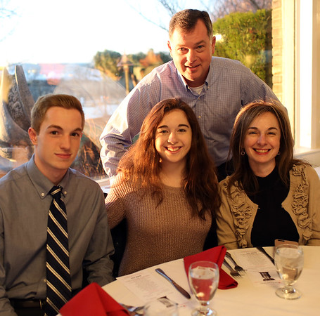 HADLEY GREEN/Staff photo<br /> Thomas O'Keefe of Swampscott sits with his family at the 2018 Salem News Student Athlete Award banquet.<br /> <br /> 04/05/18