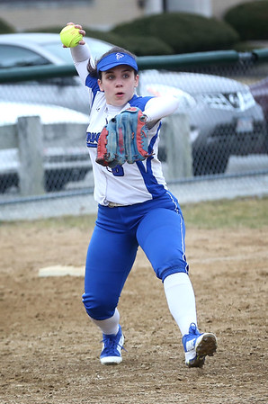 1HADLEY GREEN/Staff photo<br /> Danvers' Paige Wodarski (8) fields the ball and throws to first at the Danvers v. Peabody girls softball game.<br /> <br /> 04/10/18