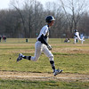 HADLEY GREEN/Staff photo<br /> Danvers' Anthony Olszak (11) runs home to score at the Peabody v. Danvers baseball game.<br /> <br /> 04/11/18