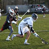 HADLEY GREEN/Staff photo<br /> Hamilton-Wenham's Andrew Riccio (14) chases the ball while Ipswich's Jack Sotiropoulos (21) plays defense at the Hamilton-Wenham v. Ipswich boys lacrosse game.<br /> <br /> 04/24/18