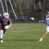 HADLEY GREEN/Staff photo<br /> Ipswich's Pat Gillis (10) runs down the field while Hamilton-Wenham's Henry Schibli (16) guards him at the Hamilton-Wenham v. Ipswich boys lacrosse game.<br /> <br /> 04/24/18