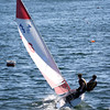 HADLEY GREEN/Staff photo<br /> A Gloucester boat navigates the wind at the Gloucester High School race against Beverly in the Gloucester Inner Harbor. <br /> <br /> 04/26/18