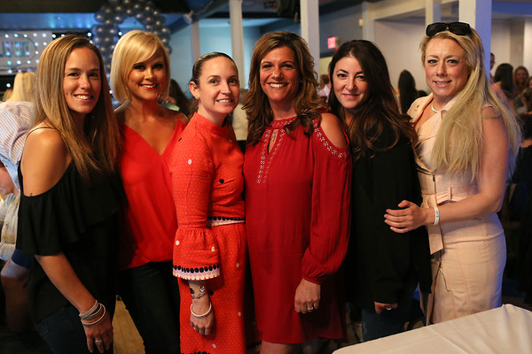 HADLEY GREEN/Staff photo<br /> From left, Jessica Mihalchik of Lynnfield, Melissa Cucciniello of Lynnfield, Kara Grant of Melrose, Sherri Breau of Londonderry, Liza Raso of Lynnfield and Laura Moynihan of Melrose attend a fundraiser for Ella's Army, a nonprofit created in memory of Ella O'Donnell, a Peabody girl who died of a brain tumor.<br /> <br /> 04/26/18