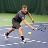 HADLEY GREEN/Staff photo<br /> Gordon's Peter Godwin leaps for the ball during a doubles match at the Endicott College v. Gordon College boys tennis match.<br /> <br /> 04/06/18