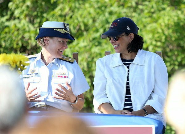 Salem Mayor Kim Driscoll, right, and Rear Admiral Linda Fagan of the United State Coast Guard, share a laugh during a short ceremony on Wednesday morning to turn over the deed for Bakers Island from the US Coast Guard to the Essex National Heritage Commission. DAVID LE/Staff photo. 8/27/14.