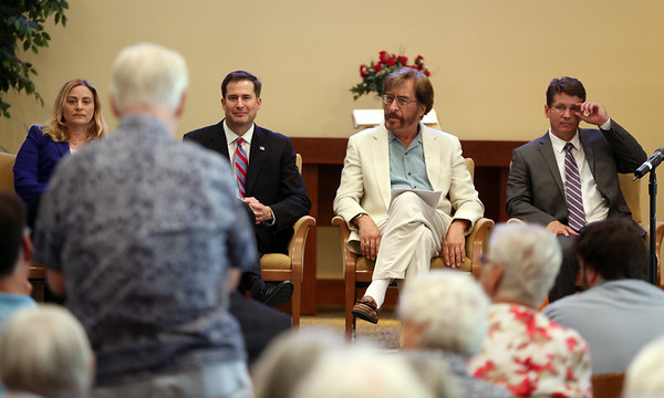 Democratic congressional candidates from left, Marisa DeFranco, Seth Moulton, John Gutta, and John Devine listen to a question from a Brooksby Village resident during a Congressional Forum held in the MacIntosh Clubhouse on Wednesday afternoon. DAVID LE/Staff photo. 8/27/14.