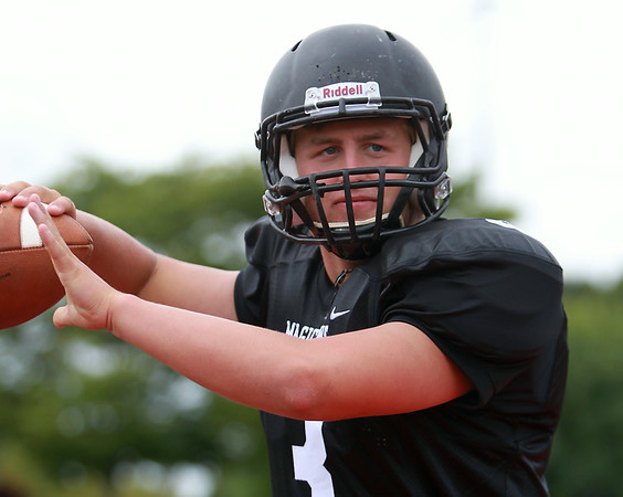 Marblehead senior captain and quarterback Spencer Craig will be the signal caller for the Magicians in 2014. DAVID LE/Staff photo. 8/22/14.