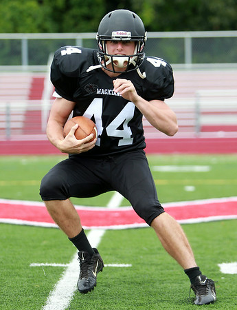 Marblehead senior running back and Notre Dame (lacrosse) commit, Brooks Tyrrell will look to make a strong push deep into the playoffs in 2014. DAVID LE/Staff photo. 8/22/14.