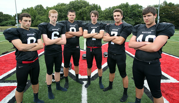 The Marblehead Magicians 2014 receiving corp will include seniors Tyler Bial (8), Teddy Camp (6), Will Millett (9), Casen Sullivan (4), captain Robert Hill, and junior Mark Cohen (40).  DAVID LE/Staff photo. 8/22/14.