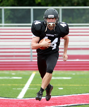 Marblehead senior captain and running back Brooks Tyrrell (44) and the Magicians will look to make another deep postseason run in 2014. DAVID LE/Staff photo. 8/22/14.