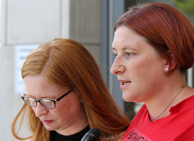 KEN YUSZKUS/Staff photo    Sarah Turner, left, is the victim of an alleged beating by Peter Turco. Her sister Shannon Turner is on the right. Sarah and Shannon were in Salem District Court for the case against Peter Turco. 08/17/16