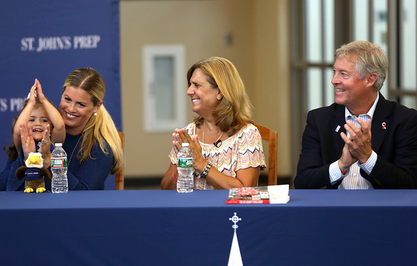 HADLEY GREEN/Staff photo<br /> From left, Pete Frates' wife Julie, their daughter Lucy, Nancy Frates, and John Frates applaud after St. John's Prep honored Pete with the 2018 Distinguished Alumnus Award and retired his number three jersey. 08/30/17