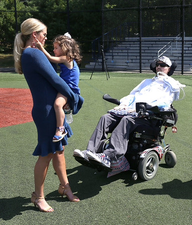 HADLEY GREEN/Staff photo<br /> Pete Frates' daughter, Lucy, and his wife, Julie, stand with Pete Frates on the Pete Frates '03 Diamond at St. John's Prep. 08/30/1708/30/17