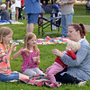 RYAN HUTTON/ Staff photo<br /> Emily Udy, right, enjoys some ice cream with her daughters Tessa, 10, left, Meg, 8, center and Caroline, 1, at the Salem Heritage Days Ice Scream Bowl at the Salem Common on Tuesday.