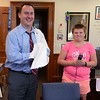 RYAN HUTTON/ Staff photo<br /> Alaina Hutchinson, 12, smiles as Peabody Mayor Ted Bettencourt shakes the hair off his shoulders in his office on Wednesday in fulfillment of a promise Bettencourt made to the Higgins Middle School seventh grader when she cut off all her hair in June to support kids with cancer.
