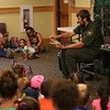 HADLEY GREEN/Staff photo<br /> Mack Ralbovsky demonstrates how an American alligator opens its mouth at the Rainforest Reptiles show at the Flint Library in Middleton. 8/15/17