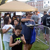 RYAN HUTTON/ Staff photo<br /> James Matthews, 6,  his mom Maria and friends Nicholas DaSilva, 10, and Natalia Mechado, 10, exit the line for Treadwell's ice cream at the Salem Heritage Days Ice Scream Bowl at the Salem Common on Tuesday.