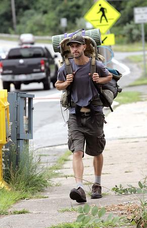 Maine author, Liam Burnell, walks along Route 62