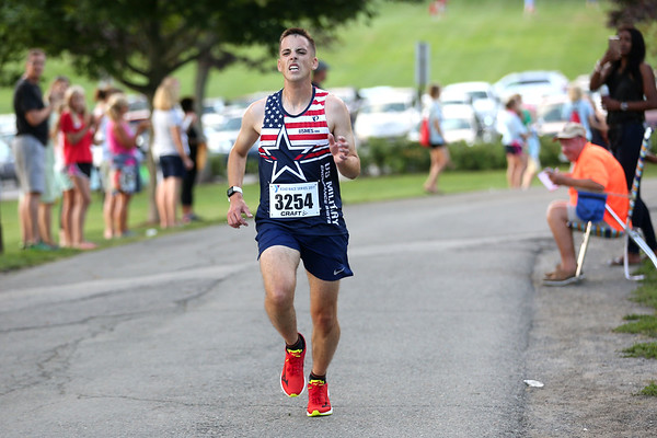 HADLEY GREEN/Staff photo<br /> John Page comes in second at the Beverly Homecoming Road Race at Lynch Park. 8/03/17