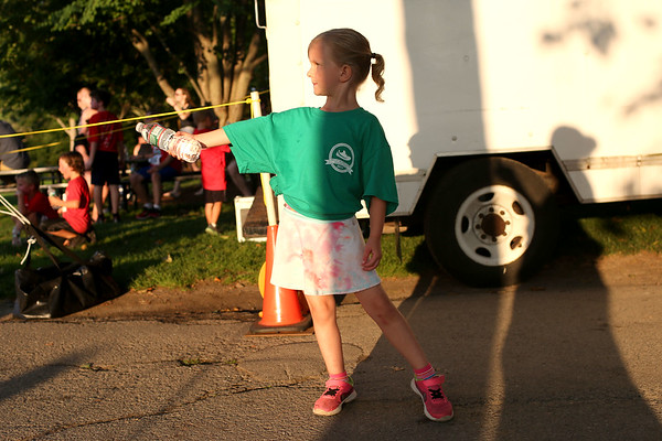 HADLEY GREEN/Staff photo<br /> Haley Brown of Beverly hands out water at the finish line of the Beverly Homecoming Road Race at Lynch Park. 8/03/17