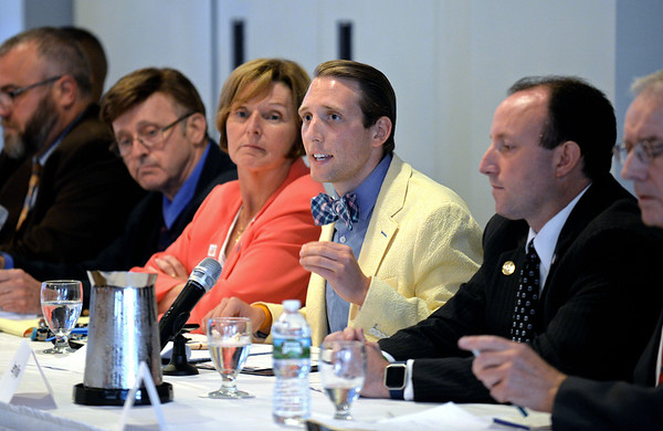 RYAN HUTTON/ Staff photo<br /> Salem City Council at-large candidate Brendan Peltier answers a question on small business policy during Tuesday night's debate at the Salem Waterfront Hotel ballroom put on by the Salem News and Salem Chamber of Commerce. From left, other candidates pictured are David Eppley, Thomas Furey, Elaine Milo, Jerry Ryan and Arthur Sargent.