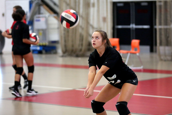 HADLEY GREEN/Staff photo<br /> Senior Emily Nikolopoulos keeps her eyes on the ball during a drill at Salem High's girls varsity volleyball practice. 8/25/17