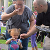 RYAN HUTTON/ Staff photo<br /> Amelia Hayes, 2, protests as her dad Jon and mom Heidi sample some of her ice cream at the Salem Heritage Days Ice Scream Bowl at the Salem Common on Tuesday.