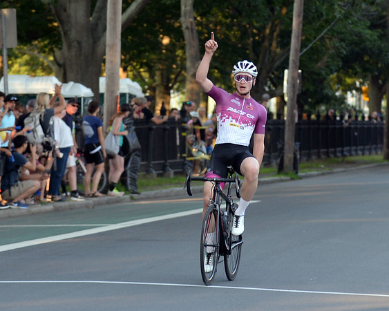 RYAN HUTTON/ Staff photo<br /> Peter Goguen, of Hopedale, MA,  raises his hand in victory after finishing in first place in the men's professional race of the 10th Annual Witches Cup bicycle race around Salem Common on Wednesday night.