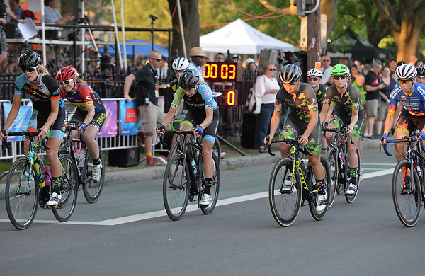RYAN HUTTON/ Staff photo<br /> Racers take off from the starting line of the women's professional race of the 10th Annual Witches Cup bicycle race around Salem Common on Wednesday night.