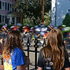 RYAN HUTTON/ Staff photo<br /> From left, Audrey Zion, 13, her twin sister Lauren, and their firend Julia Greenway, 12, watch one of the final laps of the men's amateur race speed down Washington Square East during the 10th Annual Witches Cup bicycle race around Salem Common on Wednesday night.