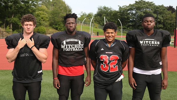 MIKE SPRINGER/Staff photo<br /> Salem Witches varsity football players, from left: Trey Defranco, Chris Ngarambe, Ruben Baez and Denzel Jean-Noel.<br /> 8/25/2018