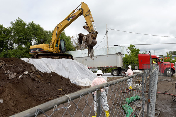 TIM JEAN/Staff photo<br /> <br /> Workers from Environmental Restoration LLC., a contractor for the EPA fill a truck in a staging area on Canal Street in Danvers. The arsenic contaminated soil is from the Brown Pond area and the cleanup is expected to be finished this fall.   8/22/18