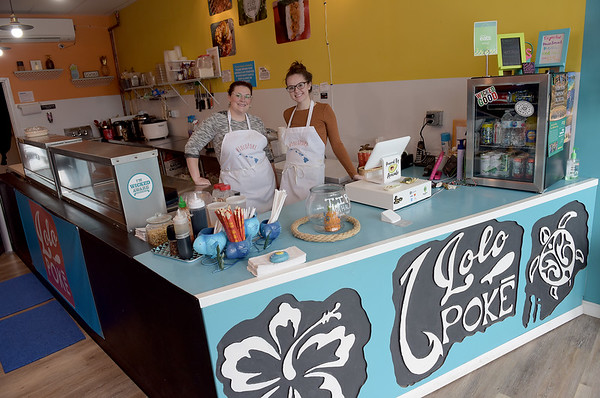TIM JEAN/Staff photo<br /> <br /> Kristen Hollingsworth, left, owner of Lolo Poke, and Michaela Shabarekh, get the restaurant ready for lunch. The new restaurant on Rantoul Street in Beverly, offers Hawaiian cuisine.    8/22/18