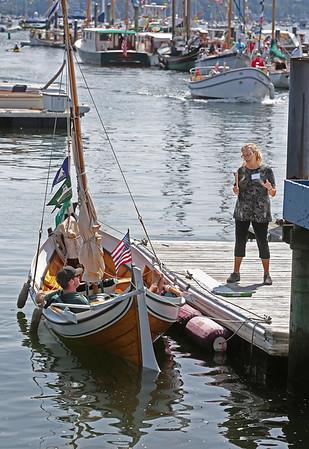 MIKE SPRINGER/Staff photo<br /> Competition judge Viking Gustafson of the Gloucester Marine Railways visits with Ryan Flynn of Rockport, captain of the Norwegian boat Kanin, during the annual Antique and Classic Boat Festival on Saturday in Salem.<br /> 8/25/18