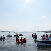 PAUL BILODEAU/Staff photo. The six boats, that participated the annual Beverly Home Coming Cardboard Boat Race at Lynch Park in Beverly, jump off the start line.   8/5/18